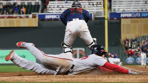 <p>               Washington Nationals' left fielder Juan Soto, right, scores on a triple by Asdrubal Cabrera as Minnesota Twins' catcher Mitch Garver chases the ball in the fifth inning of a baseball game Thursday, Sept. 12, 2019, in Minneapolis. (AP Photo/Jim Mone)             </p>