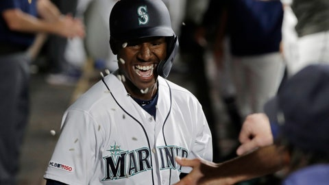 <p>               Sunflower seeds fly in the dugout as Seattle Mariners' Kyle Lewis is greeted after he hit a solo home run against the Cincinnati Reds during the fifth inning of a baseball game Thursday, Sept. 12, 2019, in Seattle. (AP Photo/Ted S. Warren)             </p>