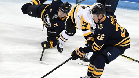 <p>               Buffalo Sabres center Jack Eichel (9) falls to the ice as Pittsburgh Penguins' Bryan Rust (17) goes after a puck controlled by Sabres' Rasmus Dahlin (26) during t an NHL preseason hockey game, Monday, Sept. 16, 2019, in State College, Pa. (AP Photo/John Beale)             </p>