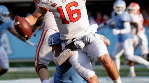 <p>               Clemson quarterback Trevor Lawrence (16) is pressured by North Carolina's Chazz Surratt (21) during the third quarter of an NCAA college football game in Chapel Hill, N.C., Saturday, Sept. 28, 2019. (AP Photo/Chris Seward)             </p>