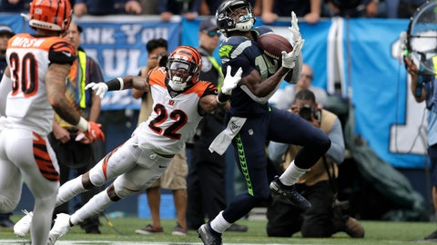 <p>               Seattle Seahawks wide receiver DK Metcalf right, makes a catch over Cincinnati Bengals cornerback William Jackson (22) during the first half of an NFL football game Sunday, Sept. 8, 2019, in Seattle. (AP Photo/Stephen Brashear)             </p>
