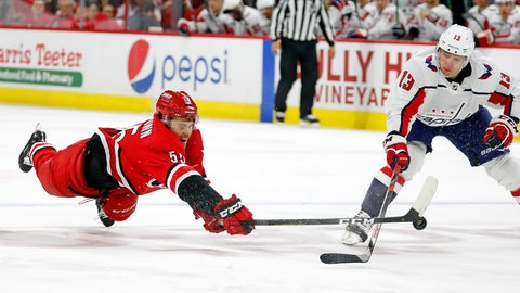 <p>               Carolina Hurricanes' Roland McKeown (55) dives to tip the puck away from Washington Capitals' Jakub Vrana (13), of the Czech Republic, during the third period of an NHL preseason hockey game in Raleigh, N.C., Sunday, Sept. 29, 2019. (AP Photo/Karl B DeBlaker)             </p>