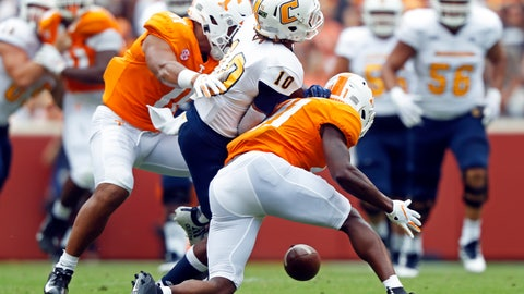<p>               Chattanooga wide receiver Lameric Tucker (10) fumbles the ball as he's hit by Tennessee defensive back Kenneth George Jr. (41) and linebacker Henry To'o To'o (11) in the first half of an NCAA college football game Saturday, Sept. 14, 2019, in Knoxville, Tenn. (AP Photo/Wade Payne)             </p>