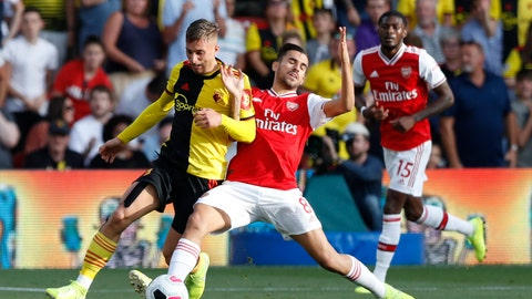 <p>               Watford's Gerard Deulofeu, left, vies for the ball with Arsenal's Dani Ceballos during their English Premier League soccer match between Watford and Arsenal at the Vicarage Road stadium in Watford near London, Sunday, Sept. 15, 2019. (AP Photo/Alastair Grant)             </p>
