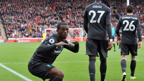 <p>               Liverpool's Georginio Wijnaldum, left, celebrates after scoring his side's opening goal during the English Premier League soccer match between Sheffield United and Liverpool at Bramall Lane in Sheffield, England, Saturday, Sept. 28, 2019. (AP Photo/Rui Vieira)             </p>