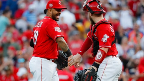 <p>               Cincinnati Reds second baseman Christian Colon (29) celebrates with catcher Tucker Barnhart, right, after closing the ninth inning of a baseball game against the New York Mets, Saturday, Sept. 21, 2019, in Cincinnati. (AP Photo/John Minchillo)             </p>