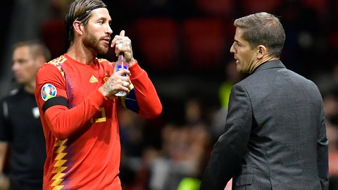 <p>               Spain's coach Roberto Moreno, right, speaks with Sergio Ramos during the Euro 2020 group F qualifying soccer match between Spain and Faroe Islands at the Molinon, stadium in Gijon, Spain, Sunday, Sept. 8, 2019. (AP Photo/Alvaro Barrientos)             </p>