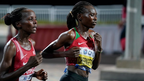 <p>               Ruth Chepngetich, of Kenya, right, leads Rose Chelimo, of Bahrain, during the women's marathon at the World Athletics Championships in Doha, Qatar, Saturday, Sept. 28, 2019. Chepngetich won the marathon. (AP Photo/Nick Didlick, Pool)             </p>