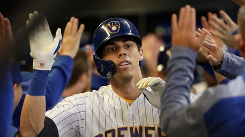 <p>               Milwaukee Brewers' Christian Yelich is congratulated after hitting a three-run home run during the third inning of a baseball game against the Chicago Cubs Friday, Sept. 6, 2019, in Milwaukee. (AP Photo/Morry Gash)             </p>