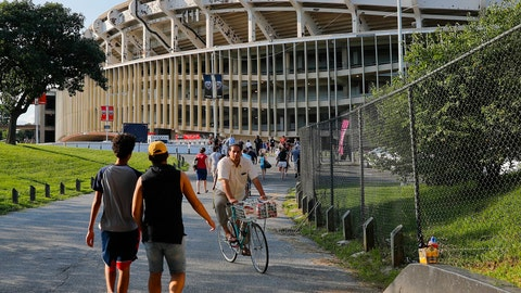 <p>               FILE - In this Aug. 5, 2017, file photo people make their way to RFK Stadium in Washington before an MLS soccer match between D.C. United and Toronto FC. The stadium, the former home of the NFL's Washington Redskins, Major League Baseball's Washington Nationals and Senators, and Major League Soccer's D.C. United, will be demolished by 2021, local officials in Washington said. (AP Photo/Pablo Martinez Monsivais, File)             </p>