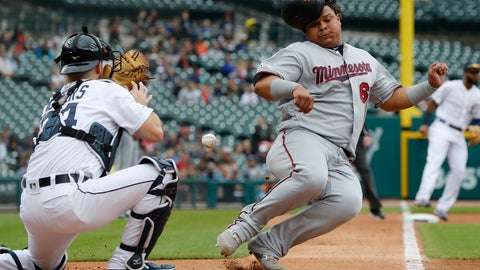 <p>               Minnesota Twins' Willians Astudillo, right, beats the throw to Detroit Tigers catcher Jake Rogers, left, to score from second on a single by teammate Jorge Polanco during the second inning of a baseball game, Sunday, Sept. 1, 2019, in Detroit. (AP Photo/Carlos Osorio)             </p>
