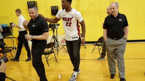<p>               Miami Heat guard Jimmy Butler (22) jokes with Heat staff following an NBA basketball news conference, Friday, Sept. 27, 2019, in Miami. Butler spoke publicly for the first time since the July trade that brought him to South Florida as the new face of the franchise. (AP Photo/Lynne Sladky)             </p>