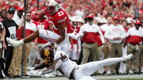 <p>               Wisconsin's Jonathan Taylor tries to leap over Central Michigan's Da'Quaun Jamison during the first half of an NCAA college football game Saturday, Sept. 7, 2019, in Madison, Wis. (AP Photo/Morry Gash)             </p>