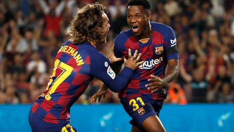 <p>               Barcelona's Ansu Fati, right, celebrates with teammate Barcelona's Antoine Griezmann after scoring the opening goal during the Spanish La Liga soccer match between FC Barcelona and Valencia CF at the Camp Nou stadium in Barcelona, Spain, Saturday, Sep. 14, 2019. (AP Photo/Joan Monfort)             </p>