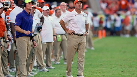 <p>               FILE - In this Saturday, Sept. 7, 2019 file photo, Clemson head coach Dabo Swinney, center, and defensive coach Brent Venables, left, watch the action during the second half of an NCAA college football game against Texas A&M in Clemson, S.C.  Tyler Davis didn't plan on starting this soon for Clemson, given the depth the Tigers had stockpiled at defensive tackle the past few seasons. Clemson coach Dabo Swinney and defensive coordinator Brent Venables had planned for the talent drain and had brought along several linemen like Williams and junior Xavier Kelly to take over. They didn't count on Davis forcing his way into the starting lineup. (AP Photo/Richard Shiro, File)             </p>