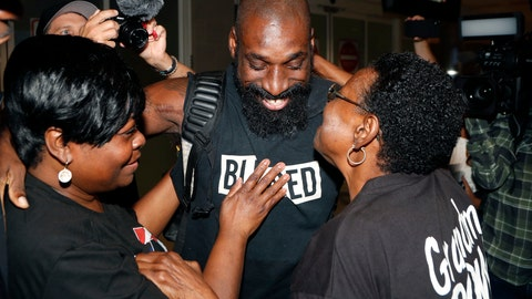 <p>               Wendell Brown hugs relatives after his arrival at the Detroit Metropolitan Airport, Wednesday, Sept. 25, 2019, in Romulus, Mich. Brown returned from China where he was imprisoned for his involvement in a bar fight. Brown, a native of Detroit had been teaching English and American football in southwest China when he was arrested in September 2016 and charged with intentional assault. (AP Photo/Carlos Osorio)             </p>