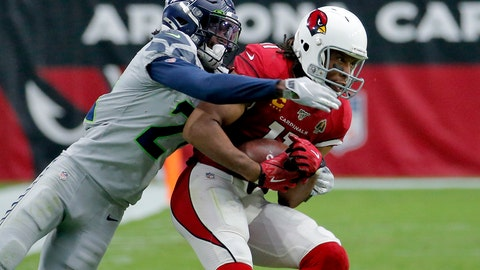 <p>               Arizona Cardinals wide receiver Larry Fitzgerald (11) pulls in a catch as Seattle Seahawks cornerback Tre Flowers (21) defends during the second half of an NFL football game, Sunday, Sept. 29, 2019, in Glendale, Ariz. (AP Photo/Rick Scuteri)             </p>