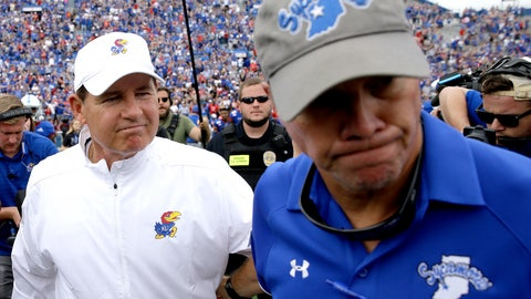 <p>               Kansas head coach Les Miles, left, and Indiana State head coach Curt Mallory part ways after shaking hands following their NCAA college football game Saturday, Aug. 31, 2019, in Lawrence, Kan. Kansas won 24-17. (AP Photo/Charlie Riedel)             </p>