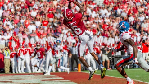 <p>               Alabama wide receiver DeVonta Smith (6) leaps into the air for his fourth touchdown reception well ahead of coverage from Mississippi defensive back Keidron Smith (20) during the first half of an NCAA college football game, Saturday, Sept. 28, 2019, in Tuscaloosa, Ala. (AP Photo/Vasha Hunt)             </p>
