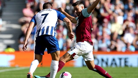 <p>               Brighton and Hove Albion's Neal Maupay, left, and Burnley's Matthew Lowton battle for the during the English Premier League soccer match between Brighton and Hove Albion and Burnley at the AMEX stadium, Brighton, England. Saturday, Sept. 14 2019 (Gareth Fuller/PA via AP)             </p>