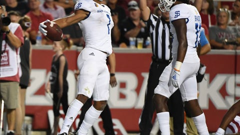 <p>               San Jose State receiver Isaiah Holiness (1) celebrates with teammate Jermaine Braddock after scoring a touchdown against Arkansas during the first half of an NCAA college football game, Saturday, Sept. 21, 2019 in Fayetteville, Ark. (AP Photo/Michael Woods)             </p>