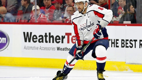 "<p>               FILE - In this April 18, 2019, file photo, Washington Capitals' Alex Ovechkin (8) works the puck against the Carolina Hurricanes during the first period of Game 4 of an NHL hockey first-round playoff series, in Raleigh, N.C. Ovechkin doesn't think he's any lighter going into his 14th NHL training camp. ""The same 260,"" he said. That might be a slight exaggeration for a player listed at 235 pounds, though the Capitals captain worked to be leaner and quicker. (AP Photo/Karl B DeBlaker, File)             </p>"
