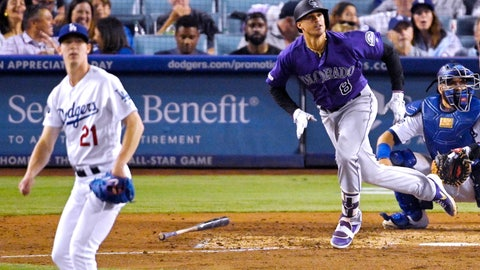 <p>               Colorado Rockies' Josh Fuentes, center, runs to first as he hits a solo home run while Los Angeles Dodgers starting pitcher Walker Buehler, left, and catcher Russell Martin watch during the seventh inning of a baseball game Saturday, Sept. 21, 2019, in Los Angeles. (AP Photo/Mark J. Terrill)             </p>