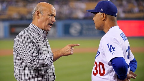 <p>               Los Angeles Dodgers co-owner Stan Kasten, left, talks with manager Dave Roberts prior to the team's baseball game against the Colorado Rockies on Friday, Sept. 20, 2019, in Los Angeles. (AP Photo/Mark J. Terrill)             </p>