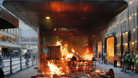 <p>               In this Sunday, Sept. 8, 2019, file photo, a fire set by protesters burns at an entrance to the Central MTR subway station in Hong Kong. Thousands of demonstrators participated in a peaceful march to the U.S. Consulate but later violence broke out in the business and retail but later after protesters vandalized a metro station and blocked traffic at a major thoroughfare, with several people detained. (AP Photo/Kin Cheung, File)             </p>