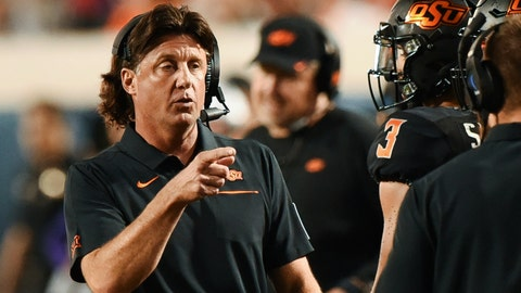 <p>               Oklahoma State head coach Mike Gundy points to his staff on the sidelines during the first half of an NCAA college football game against Kansas State, in Stillwater, Okla., Saturday, Sept. 28, 2019. (AP Photo/Brody Schmidt)             </p>