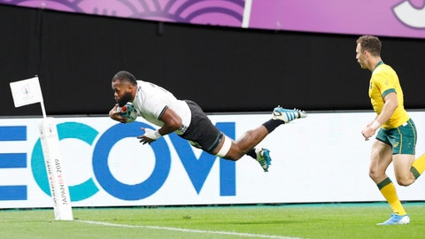 <p>               Fiji's Peceli Yato is airborne to score a try against Australia during the Rugby World Cup Pool D game at Sapporo Dome between Australia and Fiji in Sapporo, northern Japan, Saturday, Sept. 21, 2019. (Masanori Takei/Kyodo News via AP)             </p>