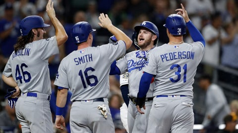 <p>               Los Angeles Dodgers' Max Muncy, second from right, greets teammates Tony Gonsolin (46), Will Smith (16), and Joc Pederson (31), after hitting a grand slam during the fourth inning of a baseball game against the San Diego Padres Tuesday, Sept. 24, 2019, in San Diego. (AP Photo/Gregory Bull)             </p>