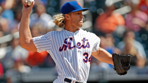 <p>               New York Mets starting pitcher Noah Syndergaard (34) winds up during the first inning of a baseball game against the Philadelphia Phillies, Sunday, Sept. 8, 2019, in New York. (AP Photo/Kathy Willens)             </p>