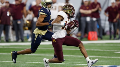 <p>               FILE - In this Dec. 26, 2018, file photo, Minnesota wide receiver Rashod Bateman (13) is chased by Georgia Tech defensive back Lamont Simmons during the first half of the Quick Lane Bowl NCAA college football game in Detroit. Tyler Johnson has the most polished credentials for Minnesota, but Bateman has quickly emerged from a deep group of wide receivers as more than just a sidekick. The Gophers play Georgia Southern this week, a school about three hours from Bateman's hometown. (AP Photo/Carlos Osorio, File)             </p>