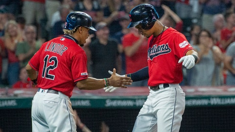 Cleveland Indians' Francisco Lindor congratulates Oscar Mercado for hitting a two-run home run off Philadelphia Phillies starting pitcher Jason Vargas during the second inning of a baseball game in Cleveland, Saturday, Sept. 21, 2019. (AP Photo/Phil Long)