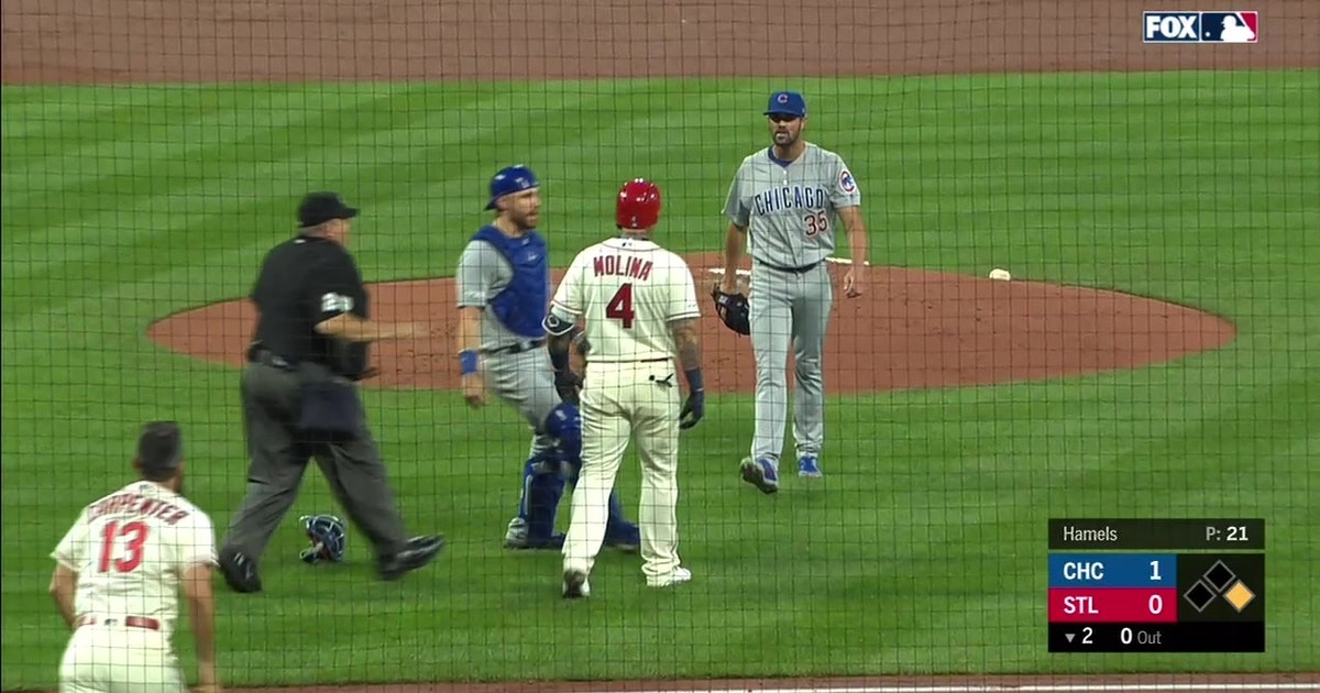 Cubs, Cardinals benches clear following Molina, Hamels heated exchange