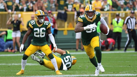 GREEN BAY, WI - SEPTEMBER 15:  Green Bay Packers defensive back Darnell Savage (26) looks on as Green Bay Packers outside linebacker Preston Smith (91) intercepts a pass during a game between the Green Bay Packers and the Minnesota Vikings on September 15, 2019 at Lambeau Field in Green Bay, WI. (Photo by Larry Radloff/Icon Sportswire via Getty Images)