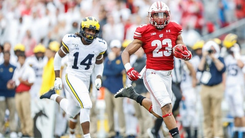 MADISON, WI - SEPTEMBER 21: Wisconsin running back Jonathan Taylor (23) runs away from Michigan defensive back Josh Metellus (14) to score a touchdown during a Big Ten college football game between the University of Wisconsin Badgers and the University Michigan Wolverines on September 21, 2019 at Camp Randall Stadium in Madison, WI. (Photo by Lawrence Iles/Icon Sportswire via Getty Images)