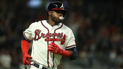 Sep 17, 2019; Atlanta, GA, USA; Atlanta Braves second baseman Adeiny Hechavarria (24) jogs around the bases after hitting a solo home run in the eighth inning against the Philadelphia Phillies at SunTrust Park. Mandatory Credit: Jason Getz-USA TODAY Sports