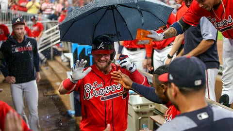 Sep 6, 2019; Atlanta, GA, USA; Atlanta Braves third baseman Josh Donaldson (20) celebrates with an umbrella after hitting a home run against the Washington Nationals in the seventh inning at SunTrust Park. Mandatory Credit: Brett Davis-USA TODAY Sports