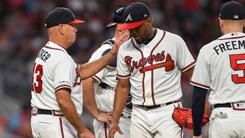 Sep 18, 2019; Atlanta, GA, USA; Atlanta Braves manager Brian Snitker (43) removes starting pitcher Julio Teheran (49) from the game against the Philadelphia Phillies during the sixth inning at SunTrust Park. Mandatory Credit: Dale Zanine-USA TODAY Sports