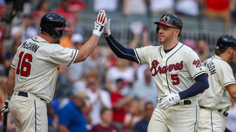 Sep 1, 2019; Atlanta, GA, USA; Atlanta Braves first baseman Freddie Freeman (5) celebrates with catcher Brian McCann (16) after a home run against the Chicago White Sox in the first inning at SunTrust Park. Mandatory Credit: Brett Davis-USA TODAY Sports