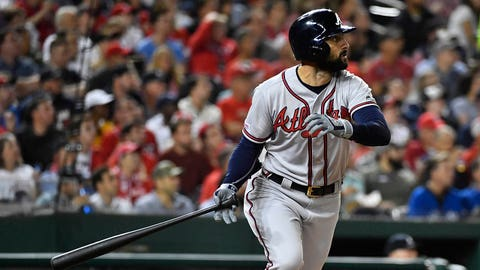 Sep 13, 2019; Washington, DC, USA; Atlanta Braves left fielder Nick Markakis (22) hits an RBI sacrifice fly against the Washington Nationals during the fifth inning at Nationals Park. Mandatory Credit: Brad Mills-USA TODAY Sports