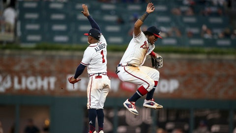 Sep 3, 2019; Atlanta, GA, USA; Atlanta Braves second baseman Ozzie Albies (1) and center fielder Ronald Acuna Jr. (13) celebrate after defeating the Toronto Blue Jays at SunTrust Park. Mandatory Credit: Brett Davis-USA TODAY Sports