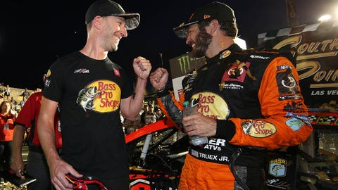 LAS VEGAS, NEVADA - SEPTEMBER 15: Martin Truex Jr., driver of the #19 Bass Pro Shops Toyota, and crew chief Cole Pearn celebrates in victory lane after winning the Monster Energy NASCAR Cup Series South Point 400 at Las Vegas Motor Speedway on September 15, 2019 in Las Vegas, Nevada. (Photo by Chris Graythen/Getty Images)