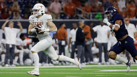 <p>               Texas wide receiver Jake Smith races to the end zone after making a catch past Rice defensive back Prudy Calderon (4), for a 53-yard touchdown during the first half of an NCAA college football game Saturday, Sept. 14, 2019, in Houston. (AP Photo/Eric Gay)             </p>