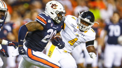 <p>               Auburn running back JaTarvious Whitlow (28) carries the ball as he tries to get around Kent State linebacker Cepeda Phillips (4) during the first half of an NCAA college football game Saturday, Sept. 14, 2019, in Auburn, Ala. (AP Photo/Butch Dill)             </p>