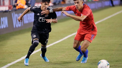 <p>               U.S. midfielder Alfredo Morales (15) fends off Mexico midfielder Uriel Antuna (26) during the second half of an international friendly soccer match Friday, Sept. 6, 2019, in East Rutherford, N.J. Mexico won 3-0. (AP Photo/Kathy Willens)             </p>