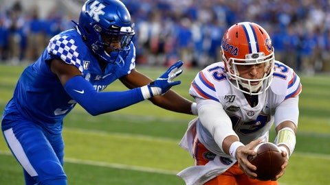 <p>               Florida quarterback Feleipe Franks (13) reaches for extra yards ahead of Kentucky safety Jordan Griffin (3) during the first half of an NCAA college football game in Lexington, Ky., Saturday, Sept. 14, 2019. (AP Photo/Timothy D. Easley)             </p>