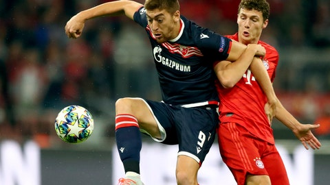 <p>               Red Star's Milan Pavkov, left, duels for the ball with Bayern's Benjamin Pavard during the Champions League group B first round soccer match between FC Bayern Munich and Red Star Belgrade, in Munich, Germany, Wednesday, Sept. 18, 2019. (AP Photo/Matthias Schrader)             </p>